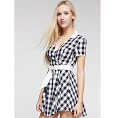 SALE 🎉 Black & White Check Belted Dress Fun & Flirty Babydoll Dress.  Black & White Gingham Check. Belted. Plunging Wrap Upper.  Off White Collar, Trim, & Belt Contrast.  Lined.  100% Cotton.  Limited Quantities.  Photos courtesy of Tea n Cup. 🎉🎉 Host Pick 🎉🎉Best in Retail 7/23 🎉🎉Cyber SALE 🎉.  Price will go back up. Tea n Cup Dresses Mini
