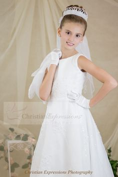 Gorgeous organza first communion gown with all over beading. Sleeveless gown with zipper back and satin buttons. Matching short sleeve organza jacket included. This first communion gown is available exclusively through Christian Expressions. http://www.firstcommunions.com/first-communion-dresses-6301.aspx