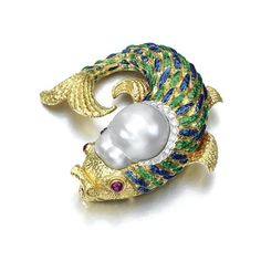 Gold, enamel, cultured pearl, ruby and diamond brooch , David Webb.   Designed as a fish, with cabochon ruby eyes, the body applied with blue and green translucent enamel, the head set with a large cultured pearl within brilliant-cut diamonds, mounted in yellow gold, signed Webb. weight 60.