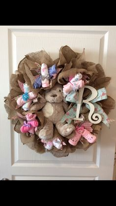 A personal favorite from my Etsy shop https://www.etsy.com/listing/483088489/baby-girl-wreath-with-removable-gifts