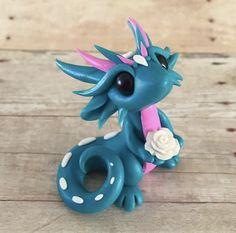 Teal rose dragon by Dragonsandbeasties