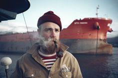 beard + boat + pipe + furrowed brow + striped shirt.