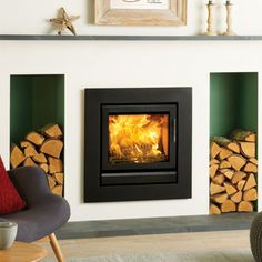 The Stovax Riva 50 Inset Multifuel / Woodburning Stove has a contemporary look and can be fitted into a wide Fireplace. The stove can be fitted as a hole in the wall stove using a four sided frame or on a hearth using the three sided fra Indoor Wood Burning Fireplace, Log Burner Fireplace, Wood Burning Fireplace Inserts, Indoor Outdoor Fireplaces, Fireplace Redo, Wood Burner, Fireplace Design, Fireplace Ideas, Inset Log Burners