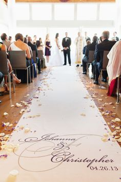The aisle runner was decorated with the couple's names and wedding date. Photo by Jonathan Young Weddings Venue: Maritime Parc Floral Design by Garden's Bloom   Gold Wedding Decorations, Ceremony Decorations, Decor Wedding, Wedding Programs, Wedding Ceremony, Church Wedding, Purple Wedding, Dream Wedding, Wedding 2017