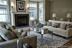 Modern Living Room with double-hung window, Cement fireplace, Fireplace, Wall sconce, Standard height, Crown molding