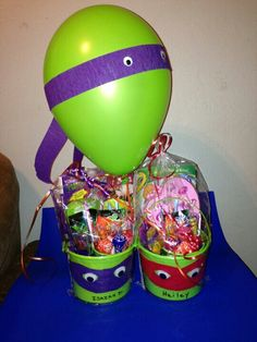 Thank you pintrest.. Ninja turtle buckets and balloons were fun to make.... My mom made these buckets for my son's birthday party they were so nice and fun for the kids...