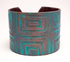 """Silver Cuff Bracelet Turquoise Polymer Clay Verdigris Patina Teal Cuff Urban Industrial Wide Cuff Hand Stamped Art Jewelry  This beautiful silver cuff bracelet is made entirely from polymer clay in a rich shade of metallic silver with a gorgeous sea green """"verdigris patina"""". Has an intricate graduated squares pattern impressed in the cuff that has been enhanced with hand painting."""