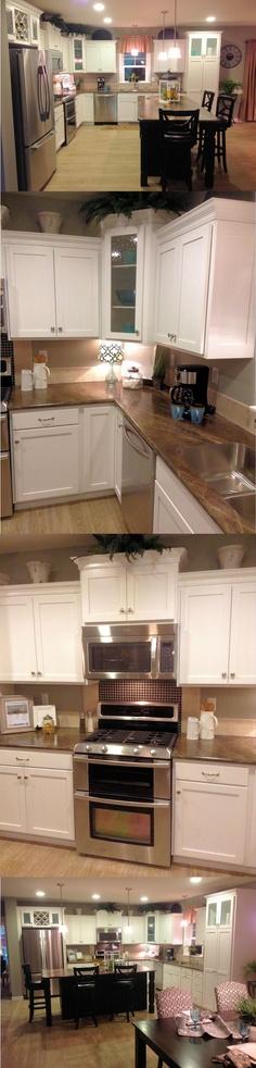 Beautiful Glacier White Kitchen with Seedy Glass, Decorative Backsplash and Black Accent Island