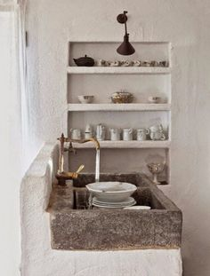 Photos Mediterranean Rustic Kitchen: A stone sink and brass faucet in the kitchen of a Spanish artist's cottage.Mediterranean Rustic Kitchen: A stone sink and brass faucet in the kitchen of a Spanish artist's cottage. Wabi Sabi, Küchen Design, Interior Design, Design Ideas, Rustic Design, Interior Styling, Design Trends, Modern Design, Interior Decorating