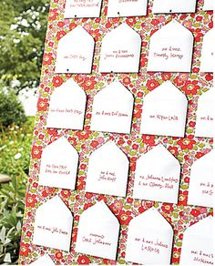 Miniature envelopes holding stamped table assignments were pinned to a fabric-covered board propped on an easel on the lawn. From Martha Stewart weddings Wedding Table Assignments, Wedding Seating Cards, Wedding Place Cards, Wedding Things, Wedding Crafts, Diy Wedding, Wedding Ideas, Wedding Decor, Wedding Reception