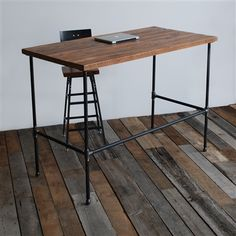 Modern Industry Standing Desk e with different height option. Custom furniture for your unique space. Sustainable and made in the USA.