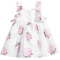 Baby girls, white, sleeveless dress by Monnalisa Bebé made from soft cotton with an all-over pretty pink hydrangea print. With a lovely laser-cut poplin bodice in pale pink, this fully lined dress has frills at the shoulders and a button fastening at the back.
