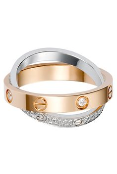 Cartier Love Ring pink and white gold ring: a pink gold band set with 4 diamonds, a fully diamond-paved white gold band. Cartier Love Ring, Cartier Jewelry, Cartier Love Bracelet, Jewelry Rings, Jewelry Accessories, Fine Jewelry, Cartier Rings, Jewlery, Bling Bling