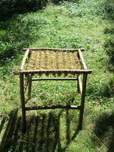 Hand made garden table with hazelnut branches and willow tree weaving.
