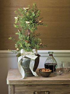 Tabletop Christmas tree made from rosemary with small gold birds