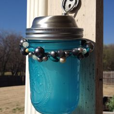 My little upcycled mason jar solar lantern. Made from the solar panel and battery section of a cheap solar light, a mason jar, paint, wire and some beads. So easy and so cool at night.
