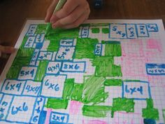 Easy & Fun Math Game for multiplication made from laminated graph paper from Teach Beside Me.