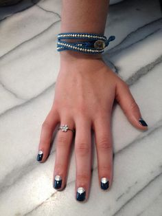 Recreate this half moon mani in 'go overboard' and 'no place like chrome.'