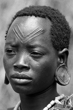 Africa   Nuer woman photographed in Ethiopia on the border with Gambela, Sudan   © Roland Vriesema