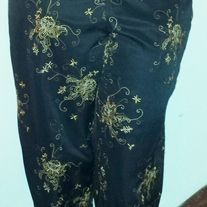 Women's size 16 (Waist 34 inches, Hips 43 inches)  These sophisticated pair of lounge pants are perfect for an evening out or an eclectic daytime ensemble. The pants are cool and casual, yet bold and striking with various gold shades of a floral embroidered design.