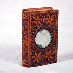 Chip-carved spruce gum box with inlaid mirror.