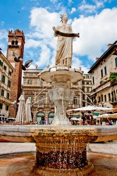 Piazza delle Erbe, Verona, Italy - We stayed in the hotel at the base of that tower. It was such a special place!