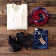 Cream or white sweater, skinnies, black ankle boots, plaid blanket scarf.