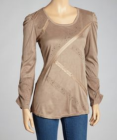 Go ahead and push the fashion envelope. With figure-flattering ribbon lines and glittering embellishments, this linen-blend top stands out from the crowd while exuding distinctly feminine style.