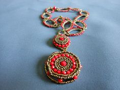 Ruby Glass, Beadwoven Pendent     See THESE beautiful photos of exotic red birds& more. Check THIS out & the latest Videos, Tips & Trends in Photography @ http://www.photopinns.com