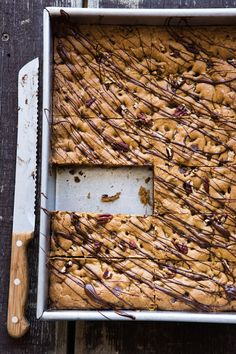 Chocolate chips and pecans add texture and contrast to this big batch of blondies. For a delicious variation, substitute butterscotch chips, or a mixture of butterscotch chips and white chocolate c...