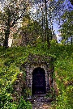A door under the mountain upon which sits Castle Bran, the home of Vlad Tepes, better known as Dracula