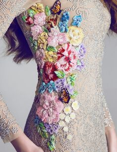Ideas swirling in my head...maybe a white empire waist dress with a tie dye belt (on the empire waist, of course) with colorful embroidery like this on the bodice and trailing down the front and around the back a little bit...