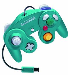 This is a rare near mint Emerald Blue Official Nintendo Gamecube Controller that was produced only in Japan.