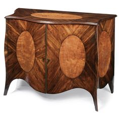 A GEORGE III INLAID GONCALOS ALVES AND SATINWOOD COMMODE CIRCA 1780