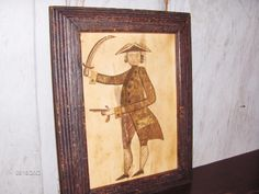 18th c. style folk watercolor of a man with sword and pistol in distressed, painted frame by Steve Shelton.  Whitehorse Antiques, Rocheport, Mo.
