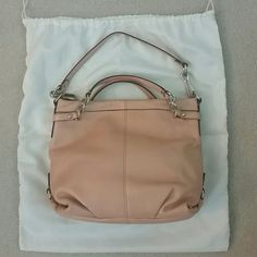 "Coach leather bag * Leather * coral pink * Inside zip, cell phone and multifunction pockets * zip-top closure, fabric lining * Approx. Measurements: 13"" (L) * 11 1/2"" (H) * 4"" (W) * Comes with dustbag Coach Bags Hobos"