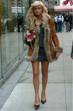 Paris Hilton in New York City wearing a fur trimmed coat.Paris always chooses to keep warm under a layer of fur. #furstyle #ParisHilton #NYC #celebrities #fur #furfashion #fashion #wiw #ootd #lotd