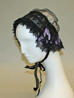 Black silk net and lace cap with lavender ribbons, American, 1847-51.