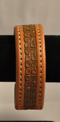 Hand tooled and painted leather cuff by Lucky2RanchSaddles on Etsy, $25.00