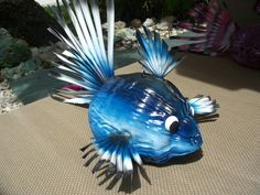 Coconut fish made with real Florida coconut and palm fronds