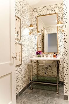 dotted walls- add a skirt around the sink & it's perfection. A red skirt