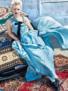 Maia Waskowskia channels her Alice character in a blue Oscar de la Renta gown with Louis Vuitton oxfords