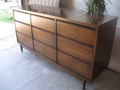 I am completely determined to find a mid-century dresser on Craigslist for cheap and refinish it!