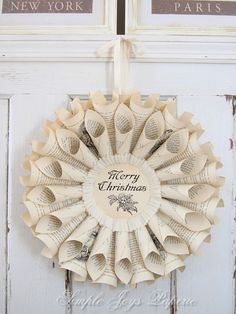 Merry Christmas Ivory Vintage Book Wreath ~ The centerpiece is an old flyleaf page or parchment paper printed with Merry Christmas and a 1920 holly berries and leaves illustration. It is surrounded by a hand-pleated, crepe paper ruffle.