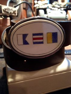 A custom Scrimshaw belt buckle hand done by Scrimshander, David Masters. https://www.nantucketchronicle.com/nantucket-marketplace/craftmasters-nantucket/scrimshaw-belt-buckle-sterling-silver