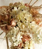 Flaunt it Fabulously  by Cindy Anderson    Flowers and Materials Featured: Gardenias, Stephanotis, Quicksand Roses, Lace and Colored Pearls and Jewels.