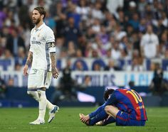 Sergio Ramos of Real Madrid walks past Lionel Messi of Barcelona as he is sent off during the La Liga match between Real Madrid CF and FC Barcelona at Estadio Bernabeu on April 23, 2017 in Madrid, Spain.