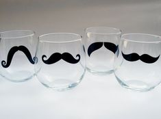 Just to make sure we don't get too classy, we have some mustache stemless wine glasses. Subtlety
