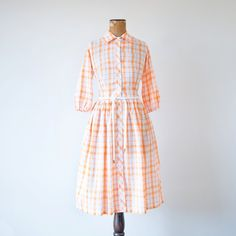 Vintage 1960s orange and white plaid shirtwaist dress - love this upbeat palette, it makes me think of a yummy Creamsicle. #vintage #dresses #1950s #1960s #fashion
