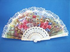 A white lace Spanish fan - beautiful..